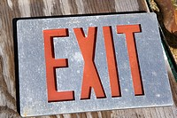 Old exit sign lying on wood