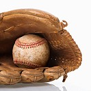 Baseball resting in baseball glove