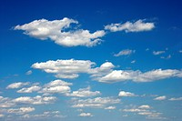 Cumulus clouds in blue sky.