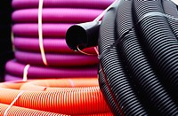 Cable ducting. Stack of flexible pipes on a building merchant yard
