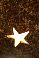 Close_up of decorative glowing star shape in metal lamp