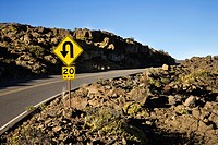 Road and curve in road sign in Haleakala National Park, Maui, Hawaii