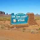 Welcome sign in desert for San Juan County in Monument Valley, Utah
