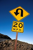 Warning road sign indicating curve and speed limit in Haleakala National Park, Maui, Hawaii