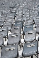 Close_up shot of several chairs in Saint Peter's Square in Vatican City, Italy