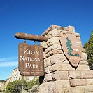 Wooden and stone sign for Zion National Park, Utah