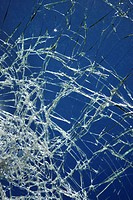 Cracked glass against blue background