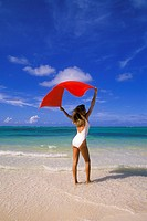 Woman on beach holding a towel, Punta Cana, Dominican Republic, Caribbean