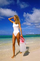 Woman on beach with snorkeling gear, Punta Cana, Dominican Republic, Caribbean