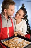 couple with christmas cookies