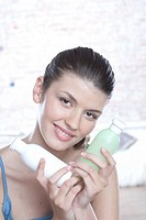 woman with face cleaning cosmetics
