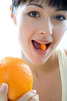 Woman with orange and vitamin (thumbnail)