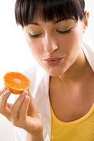 woman holding half of mandarine