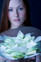 Young woman with petals on trace (thumbnail)
