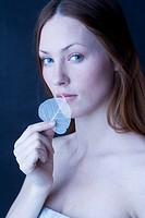 woman covering lips with leaf