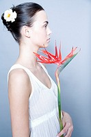 young woman with bird of paradise flower