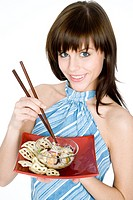 young woman eating asian noodles