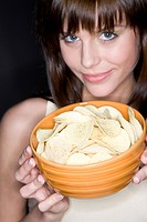 young woman with crisps