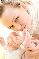 Mum kissing baby's foot (thumbnail)
