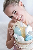 young woman with beauty care set