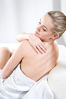 young woman creaming back