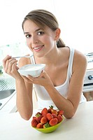 young woman eating joghurt