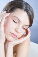 young woman massaging sinuses