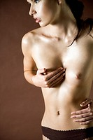 Young woman covering breast