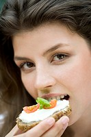 Young woman with sandwich