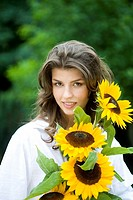 Young woman with sunflowers (thumbnail)
