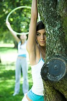 Young women exercising in park