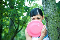 Young woman playing frisbee