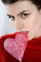 Woman with heart shaped lollipop (thumbnail)