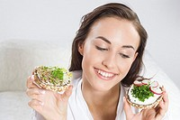 Young woman with sandwiches (thumbnail)