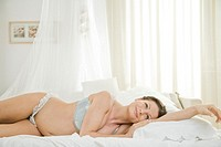 pregnant woman dreaming in bed