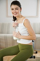 Young woman drinking milk (thumbnail)