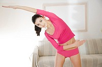 Young woman doing streaching exercising (thumbnail)
