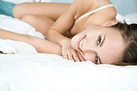 Woman in underwear lying in bed (thumbnail)