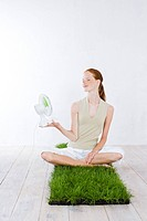 Young woman holding fan (thumbnail)