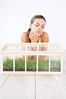 woman growing grass in the box