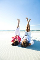 Couple relaxing on beach (thumbnail)