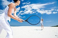 mother and daughter playing badminton
