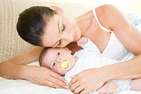 Mother and baby laying in bed (thumbnail)