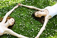 Friends laying on the grass