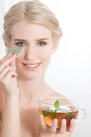 woman with teabags under eye