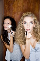 girls doing makeup in bathroom