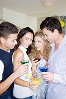 friends drinking cocktails at party
