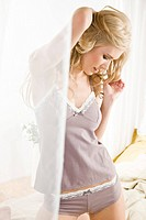 Beautiful woman in bedroom (thumbnail)