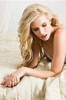 Blond woman resting in bed