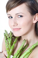 young woman with asparagus
